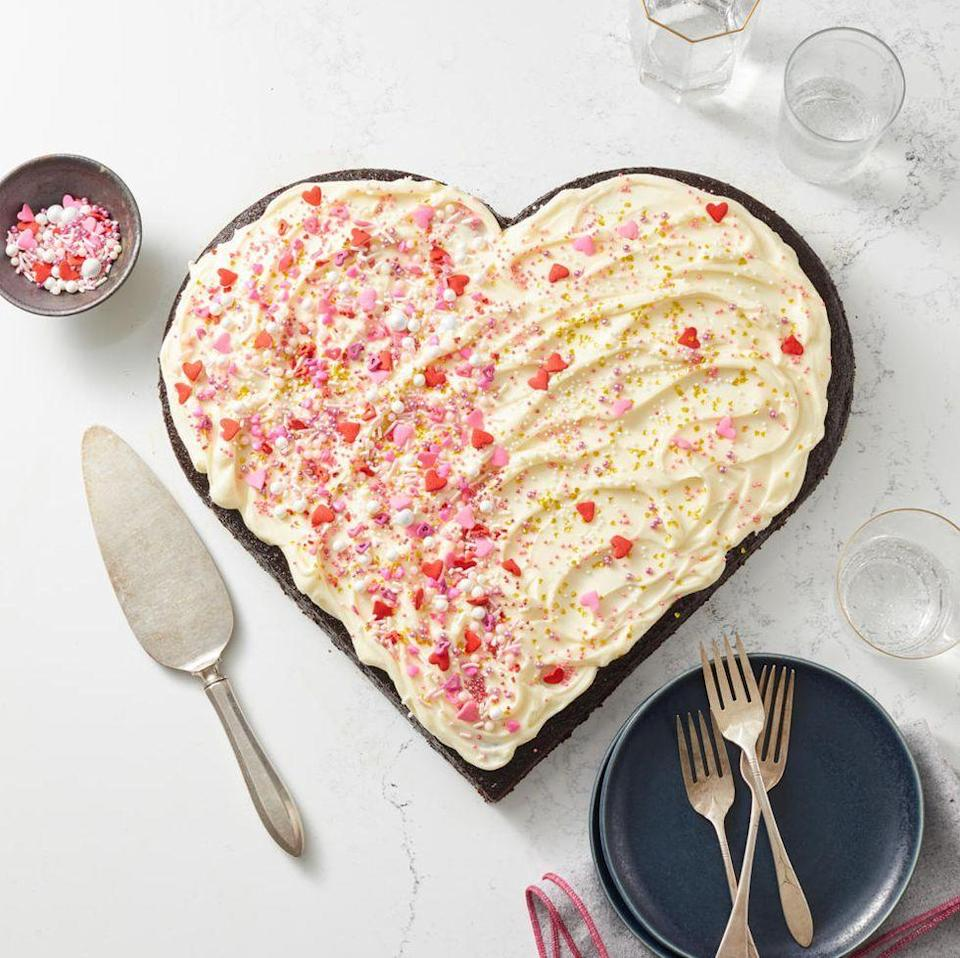 """<p>No, it's not cheesy— it's deliciously chocolatey and will win over anyone's heart.</p><p><em><a href=""""https://www.goodhousekeeping.com/food-recipes/dessert/a34865114/heart-shaped-cake-recipe/"""" rel=""""nofollow noopener"""" target=""""_blank"""" data-ylk=""""slk:Get the recipe for Heart-Shaped Cake »"""" class=""""link rapid-noclick-resp"""">Get the recipe for Heart-Shaped Cake »</a></em></p><p><strong>RELATED: </strong><a href=""""https://www.goodhousekeeping.com/holidays/valentines-day-ideas/g471/heart-shaped-foods/"""" rel=""""nofollow noopener"""" target=""""_blank"""" data-ylk=""""slk:22 Heart-Shaped Foods That Will Delight Everyone on Valentine's Day"""" class=""""link rapid-noclick-resp"""">22 Heart-Shaped Foods That Will Delight Everyone on Valentine's Day</a><br></p>"""