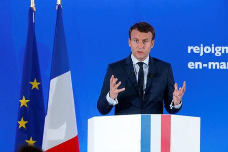 Emmanuel Macron, head of the political movement En Marche !, or Onwards !, and candidate for the 2017 French presidential election, attends a news conference at his campaign headquarters in Paris