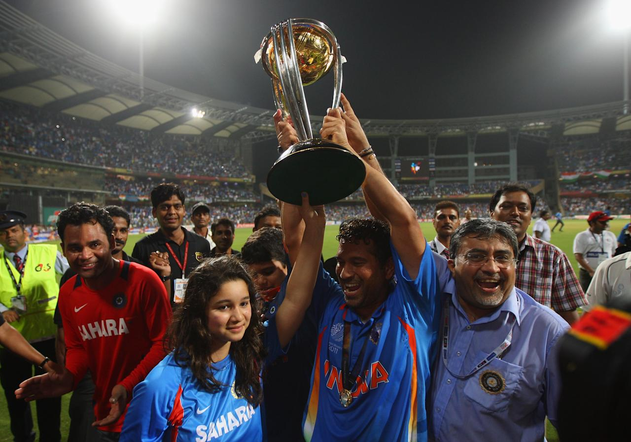 MUMBAI, INDIA - APRIL 02:  Sachin Tendulkar of India celebrates his children Sara and Arjun after India won the world cup during the 2011 ICC World Cup Final between India and Sri Lanka at the Wankhede Stadium on April 2, 2011 in Mumbai, India.  (Photo by Tom Shaw/Getty Images)