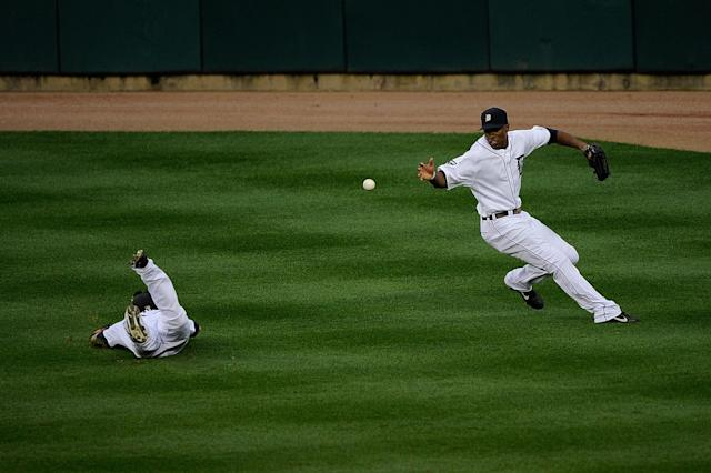 DETROIT, MI - OCTOBER 13: Austin Jackson #14 fields the ball as Ryan Raburn #25 of the Detroit Tigers fails to make a catch on a hit by David Murphy #7 of the Texas Rangers in the sixth inning of Game Five of the American League Championship Series at Comerica Park on October 13, 2011 in Detroit, Michigan. (Photo by Kevork Djansezian/Getty Images)