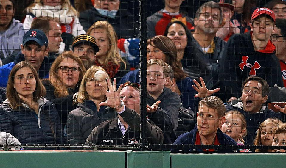 BOSTON - APRIL 19: Fans along the third base line react to a foul ball in the fourth inning despite the new protective netting during a game between the Boston Red Sox and the Tampa Bay Rays at Fenway Park in Boston on April 19, 2016. (Photo by Jim Davis/The Boston Globe via Getty Images)