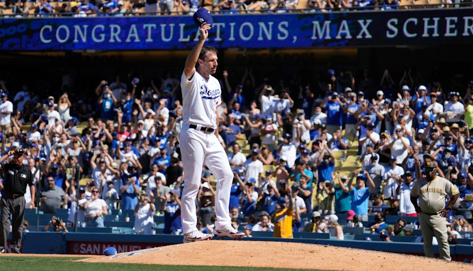 Dodgers starting pitcher Max Scherzer salutes the Los Angeles crowd after recording his 3,000th career strikeout.