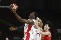 Canada's RJ Barrett drives to the net against China during the first half of a FIBA men's Olympic basketball qualifying game Wednesday, June 30, 2021, in Victoria, British Columbia. (Chad Hipolito/The Canadian Press via AP)