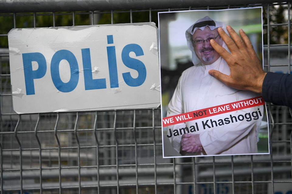 A protester holds a picture of Khashoggi, whose body has never been found, during a demonstration in front of the Saudi Arabian consulate in Istanbul on Oct. 5, 2018. (Photo: OZAN KOSE/AFP via Getty Images)