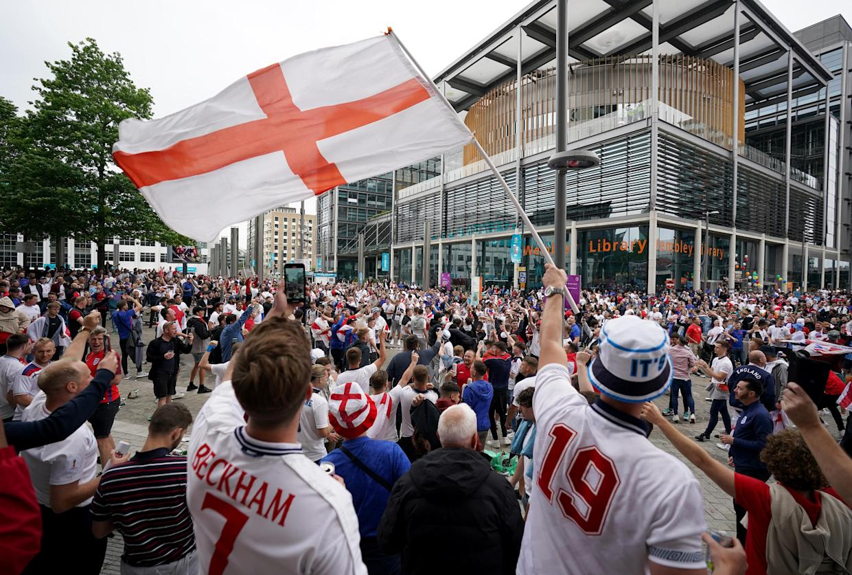 Fans arrive at Wembley ahead of the UEFA Euro 2020 round of 16 match between England and Germany at the 4TheFans fan zone outside Wembley Stadium. Picture date: Tuesday June 29, 2021.