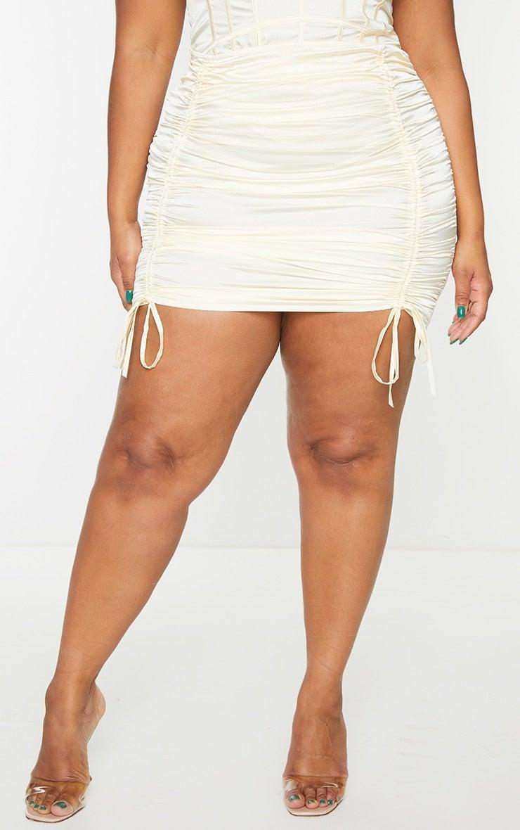 """<br><br><strong>PrettyLittleThing</strong> Plus Cream Satin Ruched Skirt, $, available at <a href=""""https://go.skimresources.com/?id=30283X879131&url=https%3A%2F%2Fwww.prettylittlething.us%2Fplus-cream-satin-ruched-skirt.html"""" rel=""""nofollow noopener"""" target=""""_blank"""" data-ylk=""""slk:PrettyLittleThing"""" class=""""link rapid-noclick-resp"""">PrettyLittleThing</a>"""