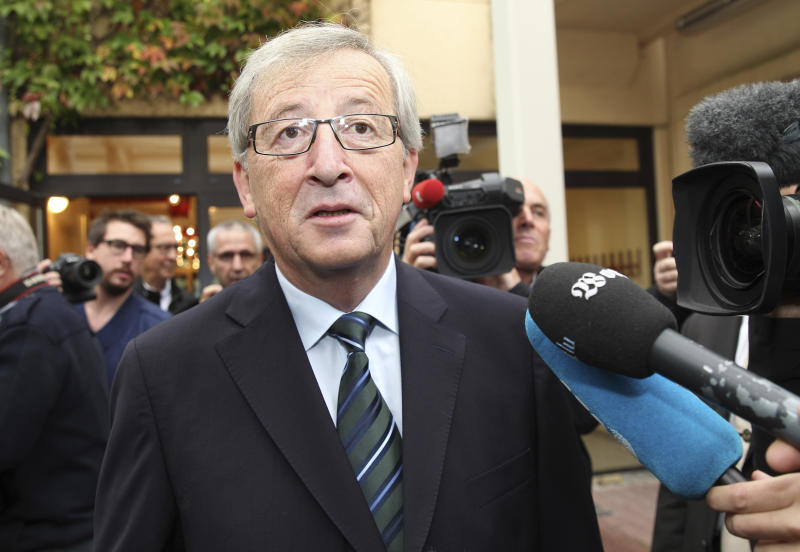Luxembourg's Prime Minister Jean-Claude Juncker addresses the media, after he casts his vote, at a polling station in Capellen, Luxembourg, Sunday Oct. 20, 2013. Polls opened in Luxembourg for legislative elections on Sunday, with Prime Minister Juncker hoping to win another term in office after an intelligence scandal brought down his government earlier this year. Juncker is the European Union's longest-serving premier after 18 years in office. (AP Photo/Yves Logghe)