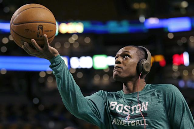 """Boston Celtics guard Rajon Rondo wears headphones as he drives to the basket during a practice before an NBA basketball game against the Los Angeles Lakers, in Boston, Friday, Jan. 17, 2014. Celtics head coach Brad Stevens and general manager Danny Ainge both said Rondo would return for the game """"barring any setbacks."""" (AP Photo/Charles Krupa)"""