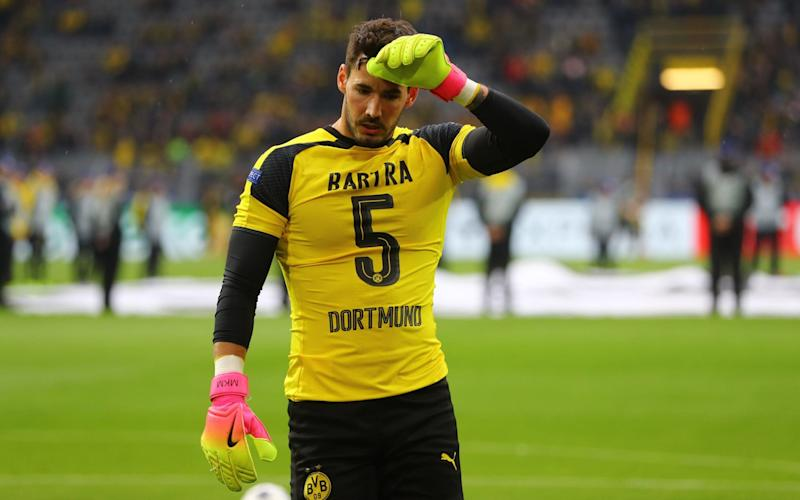 Borussia Dortmund's Roman Burki wears the shirt of Marc Bartra before the match - Credit: Reuters