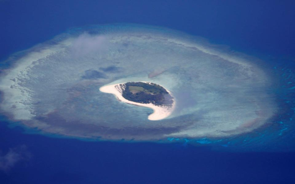 The uninhabited island of Spratly in the South China Sea is one of the many disputed territories in the region - Erik de Castro/Reuters