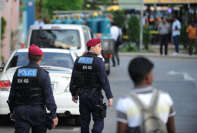 Policemen from the Special Command Operation (SOC) patrol the streets in Singapore's Little India on December 9, 2013