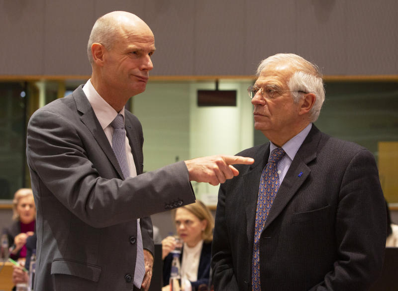 Dutch Foreign Minister Stef Blok, left, speaks with European Union foreign policy chief Josep Borrell during a meeting of EU foreign ministers at the Europa building in Brussels, Monday, Dec. 9, 2019. European Union foreign ministers are debating how to respond to a controversial deal between Turkey and Libya that could give Ankara access to a contested economic zone across the Mediterranean Sea. (AP Photo/Virginia Mayo)