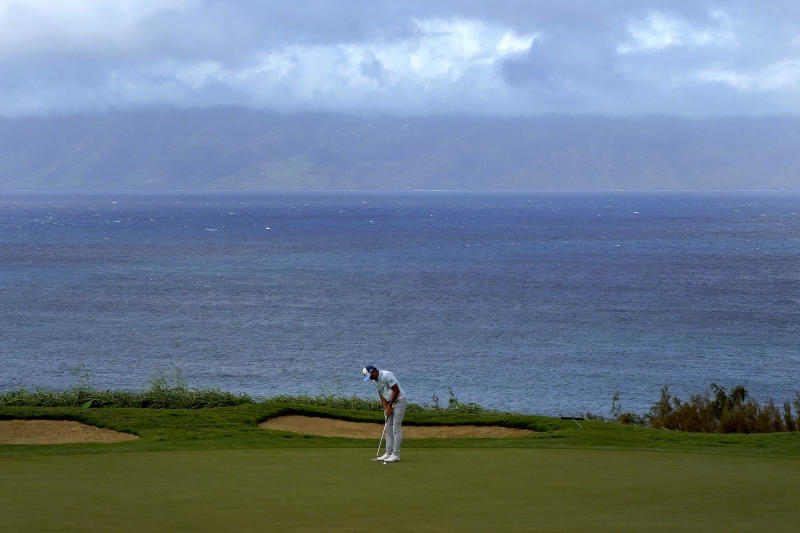 Rickie Fowler putts on the 12th green during third round of the Tournament of Champions golf event, Saturday, Jan. 4, 2020, at Kapalua Plantation Course in Kapalua, Hawaii. (AP Photo/Matt York)