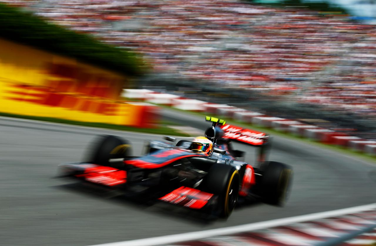 MONTREAL, CANADA - JUNE 10:  Lewis Hamilton of Great Britain and McLaren drives on his way to winning the Canadian Formula One Grand Prix at the Circuit Gilles Villeneuve on June 10, 2012 in Montreal, Canada.  (Photo by Paul Gilham/Getty Images)