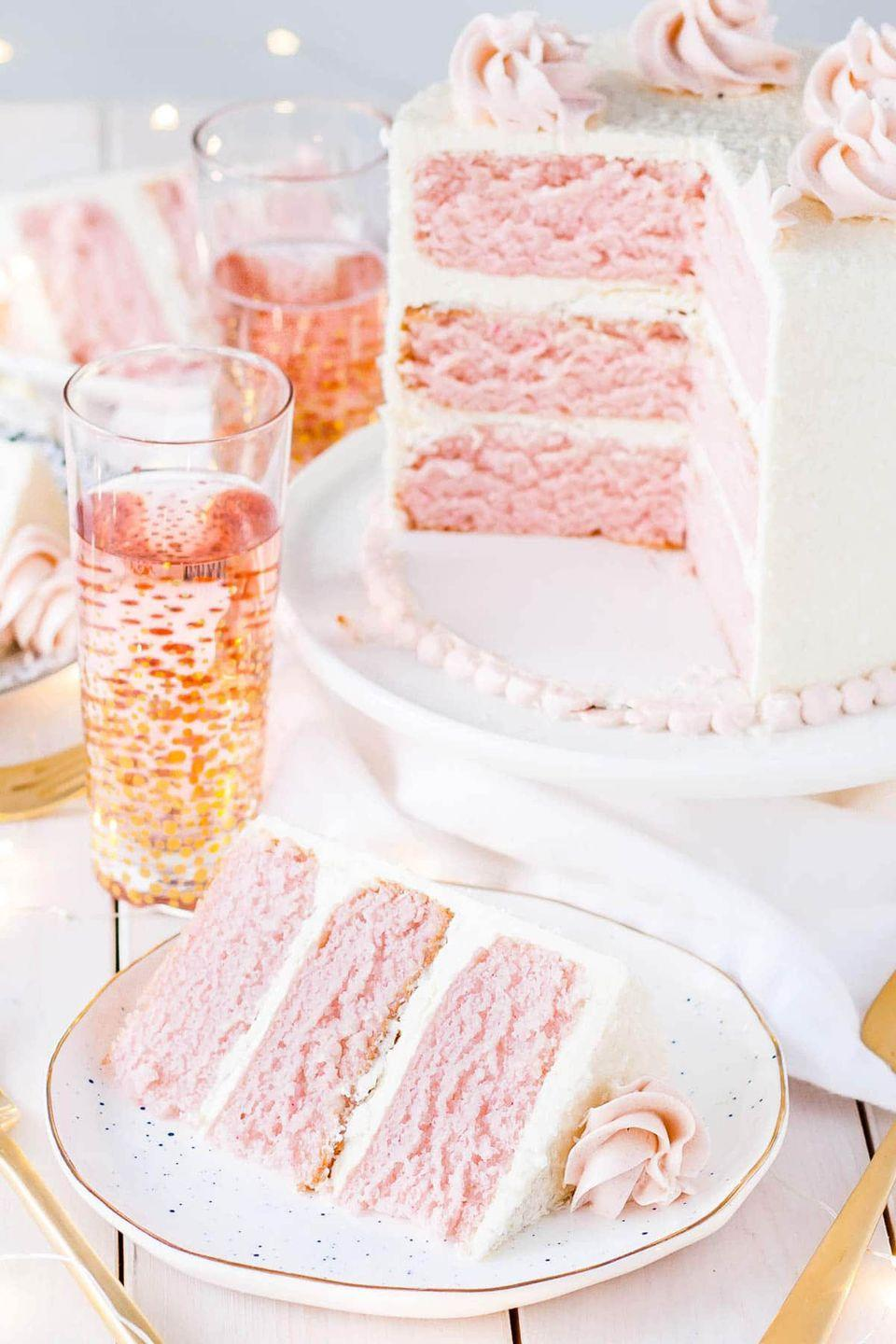 "<p>This Champagne-infused cake topped with vanilla buttercream frosting is best served with a glass of bubbly, of course!</p><p><strong>Get the recipe at <a href=""https://livforcake.com/pink-champagne-cake/"" rel=""nofollow noopener"" target=""_blank"" data-ylk=""slk:Liv for Cake"" class=""link rapid-noclick-resp"">Liv for Cake</a>.</strong></p>"