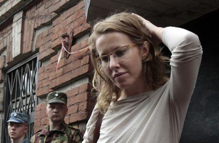 FILE PHOTO: Russian opposition leader and TV host Ksenia Sobchak talks to the media after leaving a building of the Russian Investigative Committee in Moscow