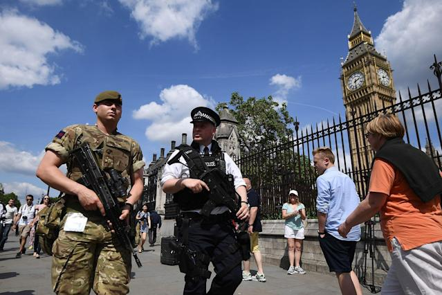 <p>An armed soldier and an armed police officer patrol outside the Houses of Parliament on May 24, 2017 in London, England. 984 military personnel are being deployed around the country as the UK terror status is elevated to Critical in the wake of the Manchester Arena Terror Attack which took place on Monday night. (Carl Court/Getty Images) </p>