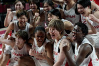 Japan players celebrate their win over Belgium in a women's basketball quarterfinal game at the 2020 Summer Olympics, Wednesday, Aug. 4, 2021, in Saitama, Japan. (AP Photo/Eric Gay)