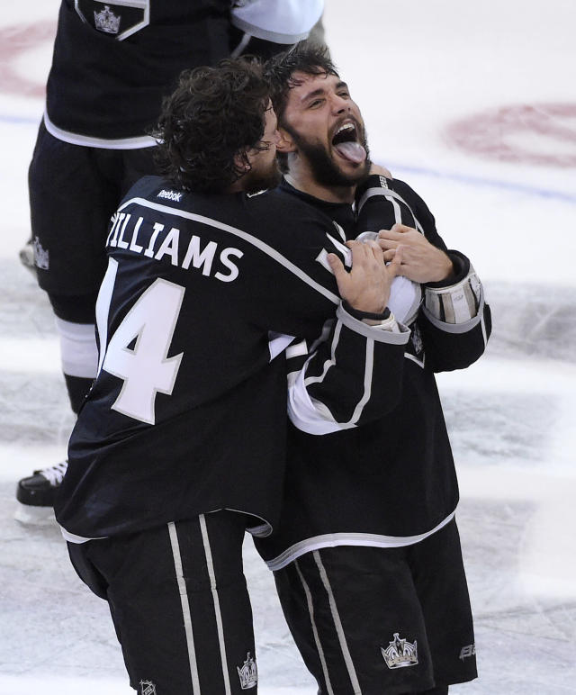 Los Angeles Kings right wing Justin Williams, left, celebrates with defenseman Alec Martinez after they won the Stanley Cup over the New York Rangers in Game 5 of an NHL hockey Stanley Cup finals, Friday, June 13, 2014, in Los Angeles. (AP Photo/Mark J. Terrill)