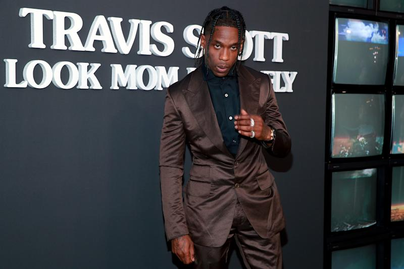 """SANTA MONICA, CALIFORNIA - AUGUST 27: Travis Scott attends the premiere of Netflix's """"Travis Scott: Look Mom I Can Fly"""" at Barker Hangar on August 27, 2019 in Santa Monica, California. (Photo by Rich Fury/Getty Images)"""
