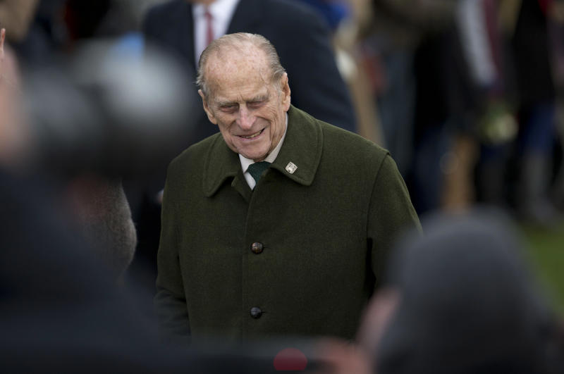 The husband of Britain's Queen Elizabeth II, Prince Philip, arrives for the British royal family's traditional Christmas Day church service in Sandringham, England, Tuesday, Dec. 25, 2012.  (AP Photo/Matt Dunham)