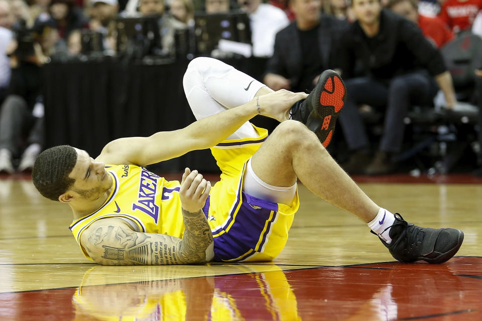 Just as they were about to get LeBron James back, the Lakers will miss Lonzo Ball for at least a month. (Photo by Tim Warner/Getty Images)
