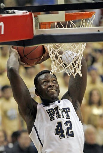 Pittsburgh's Talib Zanna (42) goes up to dunk in the first half of the NCAA college basketball game against Oakland on Saturday, Nov. 17, 2012 in Pittsburgh. (AP Photo/Keith Srakocic)