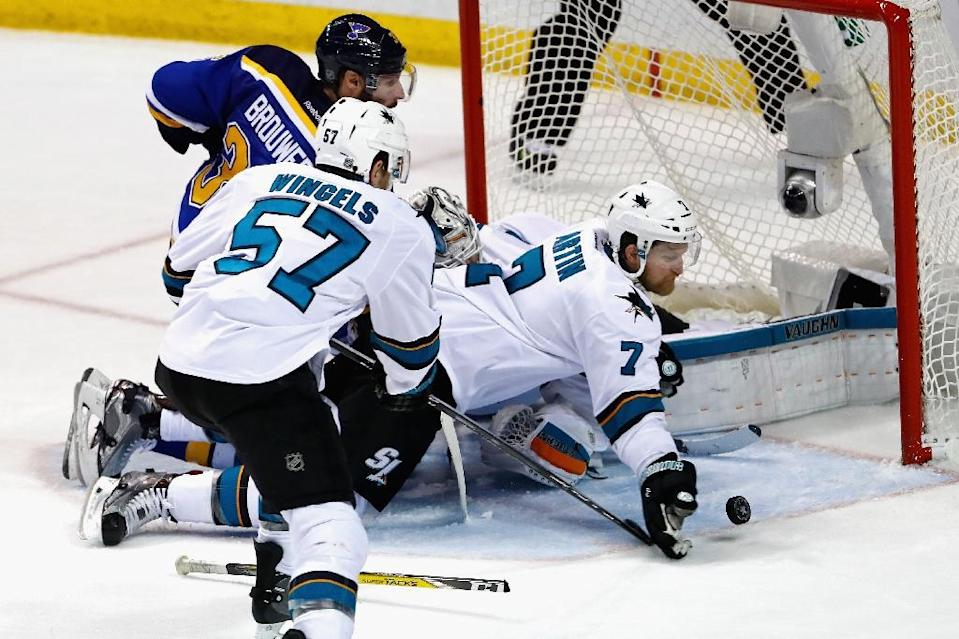 Paul Martin of the San Jose Sharks knocks the puck away from the goal against the St. Louis Blues in Game Two of the Western Conference Final (AFP Photo/Jamie Squire)