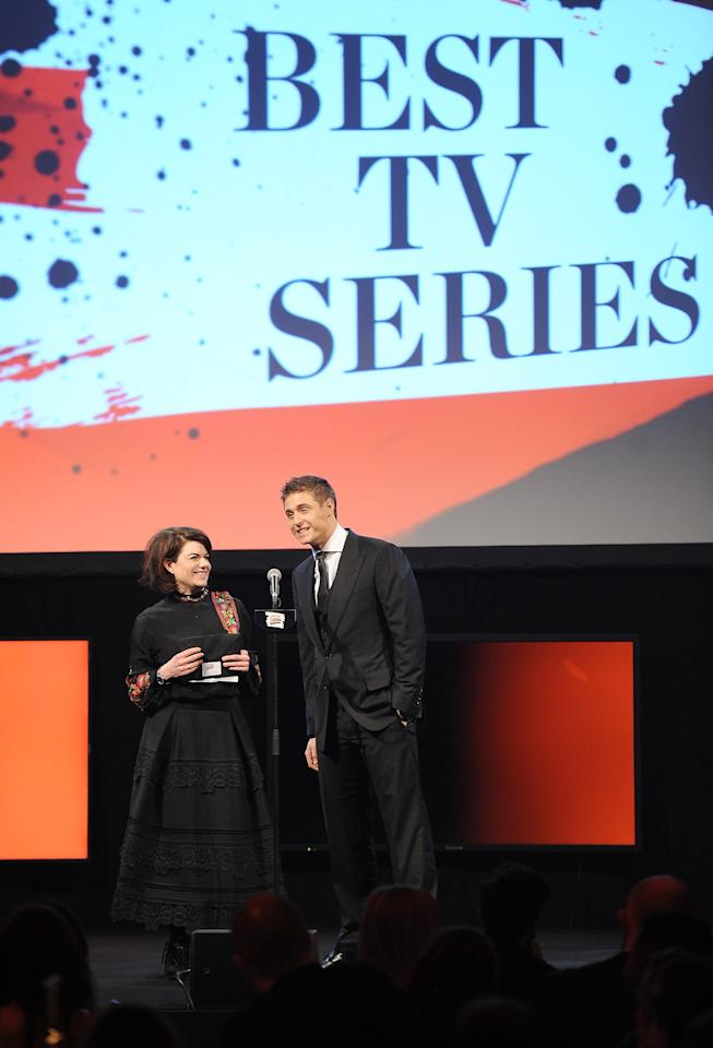 LONDON, ENGLAND - MARCH 20:  Caitlin Moran and Max Irons present the award for Best TV Series on stage during the Jameson Empire Awards 2016 at The Grosvenor House Hotel on March 20, 2016 in London, England.  (Photo by Jeff Spicer/Getty Images)