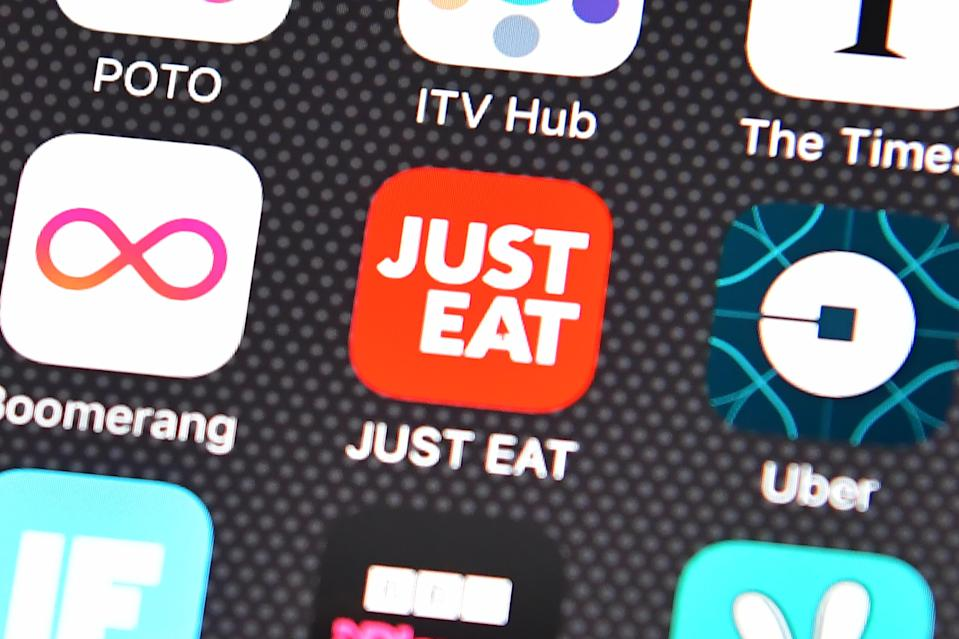 Under pressure: The Just Eat app logo is displayed on an iPhone. Photo: Carl Court/Getty Images