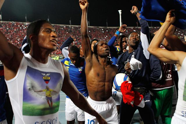 Ecuador's players, celebrate at the end of the game against Chile during a 2014 World Cup qualifying soccer game in Santiago, Chile, Tuesday, Oct. 15, 2013. Chile and Ecuador booked their World Cup place in Brazil 2014. Chile won 2-1.(AP Photo/Martin Mejia)