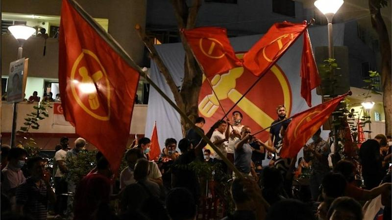 Supporters of the Workers' Party celebrate on the streets of Singapore. Photo: 11 July 2020
