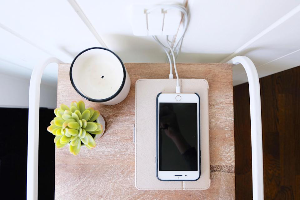 """A cord wrap or dock is a chic—and easy—way to keep all your wires in one place. You heard it here first: Bundling is one of the best cable hacks in the books. """"Electronics such as printers, computers, or phones come with a lot of connected cords,"""" says Joanna Teplin, cofounder of the Home Edit. """"Using a cord wrap or dock to organize them helps keep everything streamlined and less cluttered."""""""