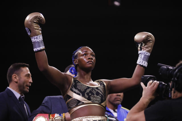 Claressa Shields stands for her introduction for a fight with Ivana Habazin in a women's 154-pound title boxing bout in Atlantic City, N.J., Friday, Jan. 10, 2020. (AP Photo/Matt Rourke)