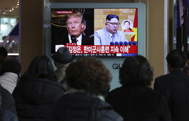 People watch a TV screen showing North Korean leader Kim Jong Un and U.S. President Trump, left, at the Seoul Railway Station in Seoul, South Korea, on March 9, 2018. (Photo: Ahn Young-joon/AP)