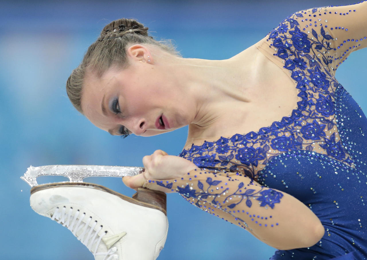 Nathalie Weinzierl of Germany competes in the women's free skate figure skating finals at the Iceberg Skating Palace during the 2014 Winter Olympics, Thursday, Feb. 20, 2014, in Sochi, Russia. (AP Photo/Ivan Sekretarev)