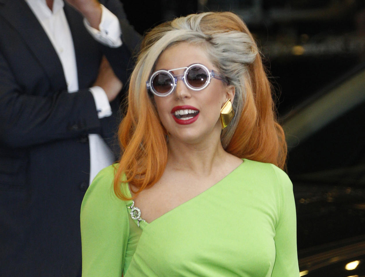 FILE - In this May 16, 2012, file photo, Lady Gaga arrives at the Sungshan airport in Taipei, Taiwan. Lady Gaga has been struck on the head by a pole while performing during the third of three shows in Auckland, Sunday, June 10, 2012. (AP Photo/Wally Santana, File)