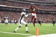 Houston Texans quarterback Deshaun Watson (4) leaps over Denver Broncos strong safety Will Parks (34) for a touchdown during the second half of an NFL football game Sunday, Dec. 8, 2019, in Houston. (AP Photo/Eric Christian Smith)