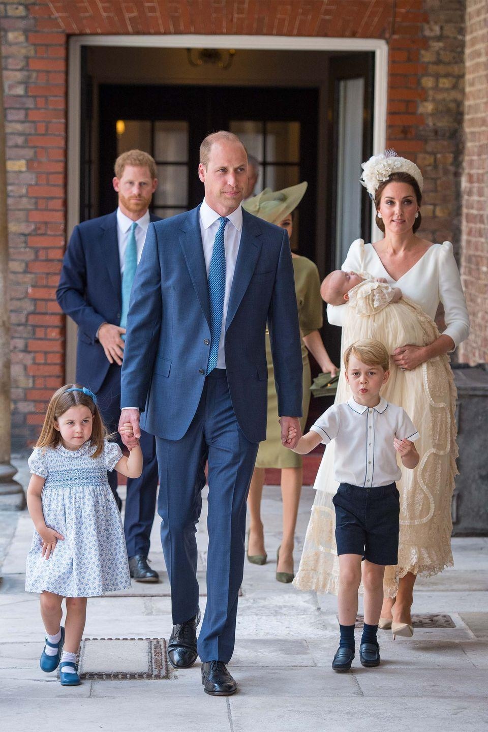 <p>Now a family of five, George and Charlotte walk hand-in-hand with Prince William as they attended the christening of their new baby brother. </p>