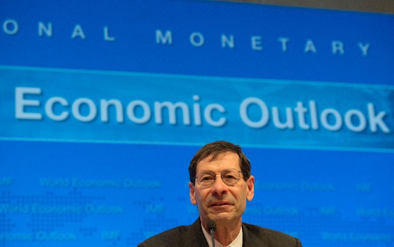 Maurice Obstfeld, Economic Counsellor and Director of Research Department, IMF, speaks during the World Economic Outlook media briefing on April 12, 2016 (AFP Photo/Molly Riley)