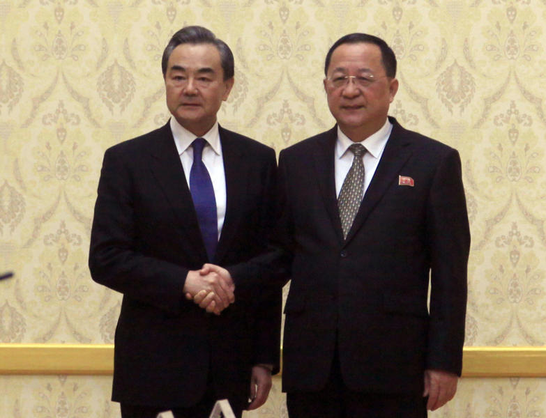 FILE - In this May 2, 2018, file photo, North Korean Foreign Minister Ri Yong Ho, right, poses with his Chinese counterpart Wang Yi at the Mansudae Assembly Hall in Pyongyang, North Korea. North Korea is sending its foreign minister to key ally China for talks amid a stall in efforts to persuade Pyongyang to dismantle its nuclear programs. Ri was due to arrive late Thursday, Dec. 6, 2018 and meet Friday, Dec. 7 with Wang. (AP Photo/Jon Chol Jin, File)