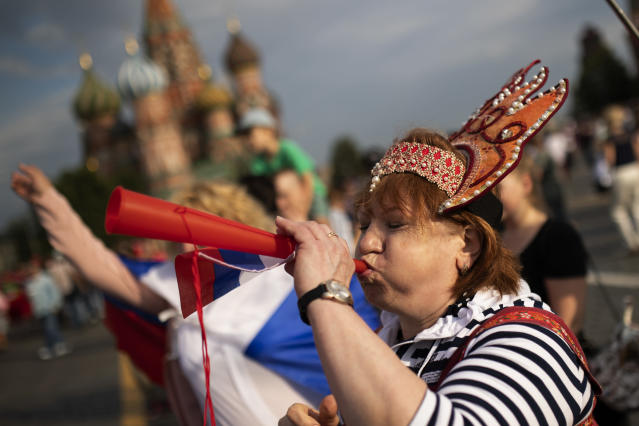 A Russian fan blows a small vuvuzela at the Red Square during the 2018 soccer World Cup in Moscow, Russia, Tuesday, June 19, 2018. (AP Photo/Francisco Seco)