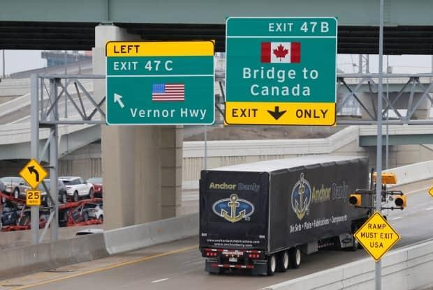 A commercial truck heads for the Ambassador Bridge, which connects Windsor, Ont., to Detroit.  (Rebecca Cook/Reuters - image credit)