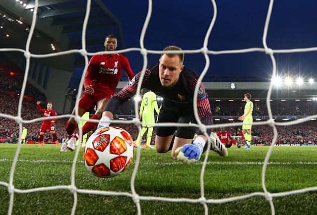 Marc-Andre Ter Stegan of Barcelona fails to stop Georginio Wijnaldum of Liverpool from scoring his team's second goal during the UEFA Champions League Semi Final second leg match between Liverpool and Barcelona at Anfield on May 07, 2019 in Liverpool, England. (Photo by Clive Brunskill/Getty Images)