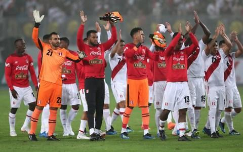 """A makeshift and inexperienced Scotland side were beaten 2-0 by World Cup-bound Peru at the frenzied Estadio Nacional in Lima. It was all going pretty well for Alex McLeish's men until the 37th minute when Christian Cueva scored from the spot after defender Scott McKenna had handled in the penalty area. Lokomotiv Moscow's Jefferson Farfan made it 2-0 from close range in the 47th minute with Millwall keeper Jordan Archer, one of four starting debutants, looking culpable again after his misjudgement had led to the earlier penalty. Peru are on the way to the World Cup for the first time in 36 years and in front of 40,000 exuberant home fans Ricardo Gareca's side, ranked 11th in the world, threatened to impose more damage. However, the Scots steadied themselves and looked solid enough while ending the night with seven new faces having made their first appearances for the national team. McLeish said: """"The first goal was a big set-back. I felt we contained Peru very well, they are a good team, technically good, very strong, quick. """"It was very disappointing to lose the goal at the moment we lost it, just before half-time. """"It was really a basic ball over the top and normally it should be easy for the defender, but we didn't deal with it well. But overall I was happy with the team's display. Scotland fielded seven debutants during the match in Lima Credit: reuters """"I thought the defenders were very strong, very organised, didn't make it easy for Peru. The second half, after the early goal, it gave them some more confidence to show their skills and at that moment in the game it was a bit difficult. """"We got over it and made a couple of chances in the end, but never really threatened the goal. But maybe if we did other things we could maybe have had a goal out of the game."""" It was always going to be difficult for McLeish to shape up a team capable of giving the South Americans a real test. After six call-offs to a squad which was already without a clutch of regulars, the forme"""