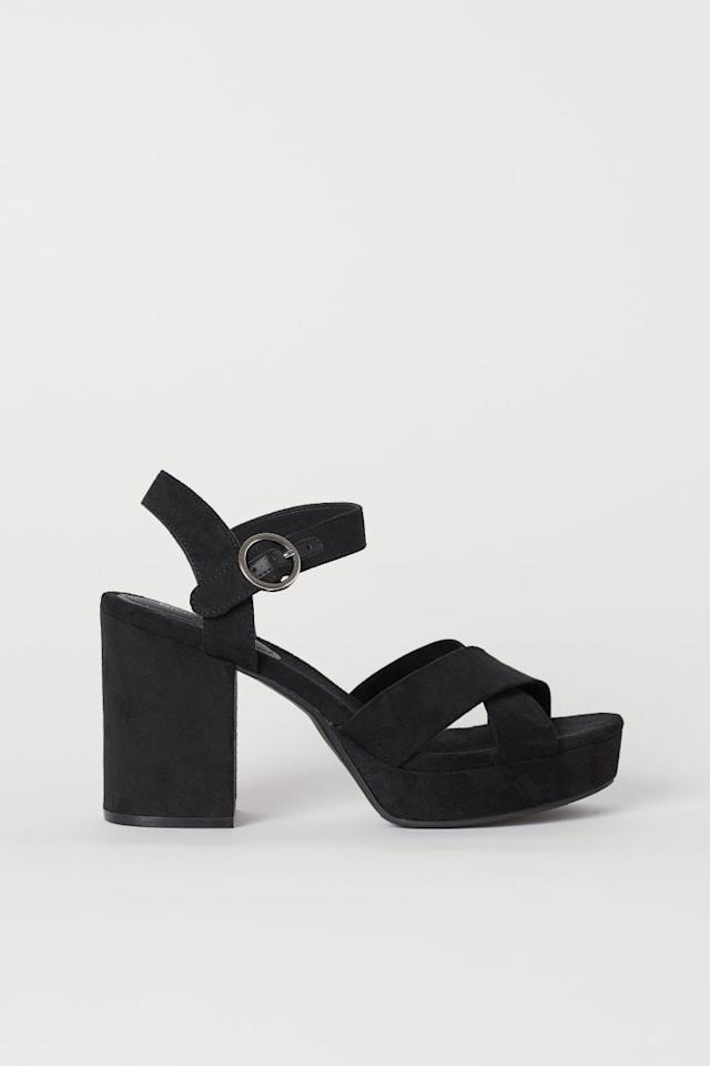 """<p>These retro-inspired <a href=""""https://www.popsugar.com/buy/HampM-Platform-Sandals-487996?p_name=H%26amp%3BM%20Platform%20Sandals&retailer=www2.hm.com&pid=487996&price=35&evar1=fab%3Aus&evar9=45623303&evar98=https%3A%2F%2Fwww.popsugar.com%2Fphoto-gallery%2F45623303%2Fimage%2F46581684%2FHM-Platform-Sandals&list1=shopping%2Cshoes%2Ctrends%2Cheels&prop13=api&pdata=1"""" rel=""""nofollow"""" data-shoppable-link=""""1"""" target=""""_blank"""" class=""""ga-track"""" data-ga-category=""""Related"""" data-ga-label=""""https://www2.hm.com/en_us/productpage.0710085002.html"""" data-ga-action=""""In-Line Links"""">H&amp;M Platform Sandals</a> ($35) are going to be your go-to party shoes.</p>"""