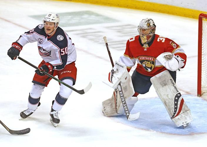 Florida Panthers goalie Spencer Knight (30) and Columbus Blue Jackets Eric Robinson (50) in the third period at the BB&T Center in Sunrise, Florida, Tuesday, April 20, 2021.
