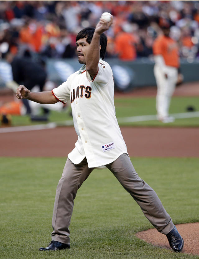 Boxer Manny Pacquiao throws a ceremonial first pitch before a baseball game between the San Francisco Giants and the Milwaukee Brewers on Friday, Aug. 29, 2014, in San Francisco. (AP Photo/Marcio Jose Sanchez)