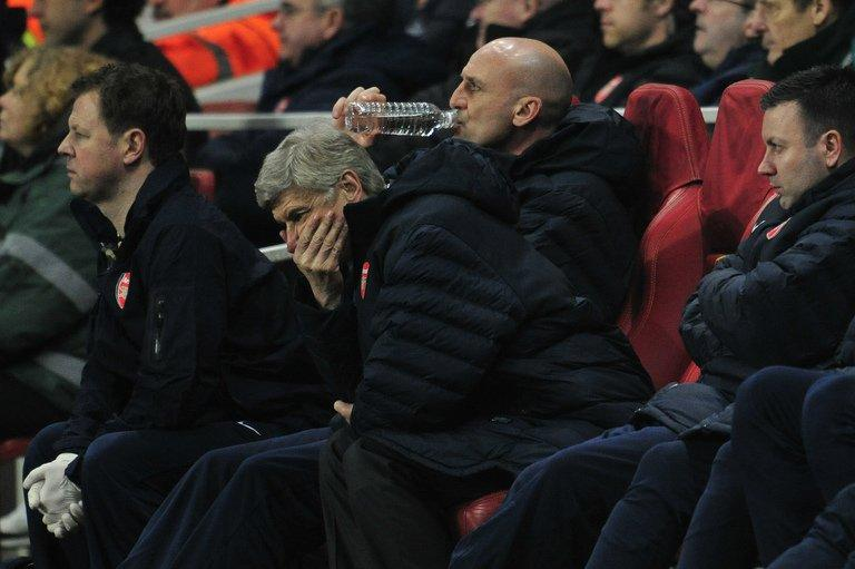 Arsene Wenger cuts a frustrated figure as he watches his side in the home defeat to Bayern Munich, on February 19, 2013