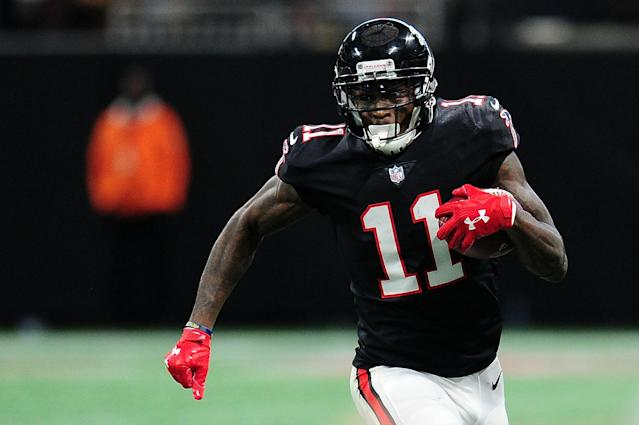 "After speculation that he would hold out from training camp while negotiating an adjustment to his contract, the <a class=""link rapid-noclick-resp"" href=""/nfl/teams/atl"" data-ylk=""slk:Atlanta Falcons"">Atlanta Falcons</a> and wide receiver Julio Jones reached an agreement on Wednesday night. (Getty Images)"